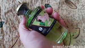 Shunga Aphrodisiac Warming Oil bottle in a woman's hand to show size