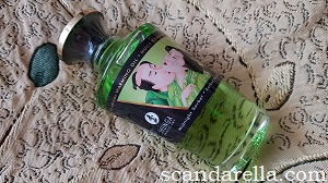 Shunga Aphrodisiac Warming Oil glass bottle with green oil and Japanese art label
