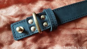 Bound Noir Nubuck Leather Collar close up of pin buckle on copper coloured background
