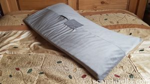 Liberator Humphrey Toy Mount review, image of a grey sex pillow positioned diagonally on a kingsized bed