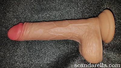 Paloqueth Ultra Realistic Dual Density Dildo Review, image of a caucasian skin-toned realistic dildo on a black background
